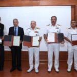 Officials of Indian Navy and Amrita Vishwa Vidyapeetham at signi...