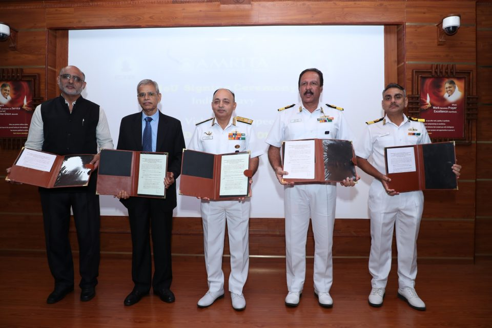 Officials of Indian Navy and Amrita Vishwa Vidyapeetham at signi...