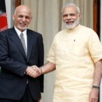 Afghan President Ashraf Ghani and India's PM Narendra Modi pose for the media outside Hyderabad House in Delhi