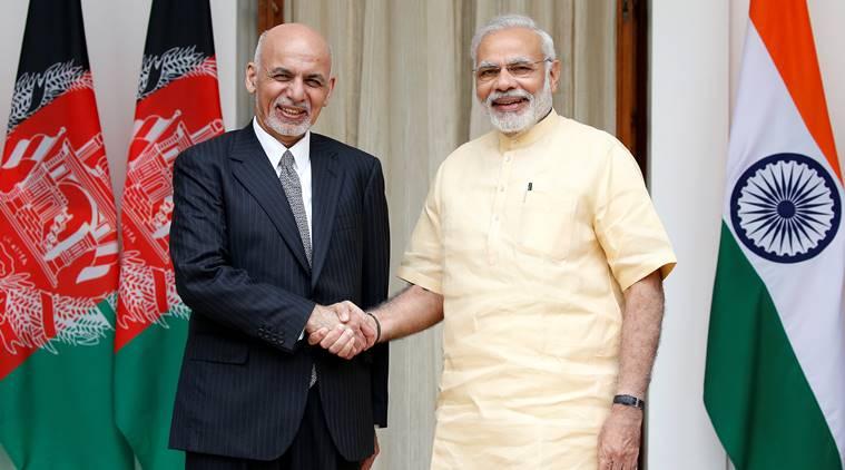 Afghan President Ashraf Ghani and India's PM Narendra Modi pose for the media outside Hyderabad House in Delhi